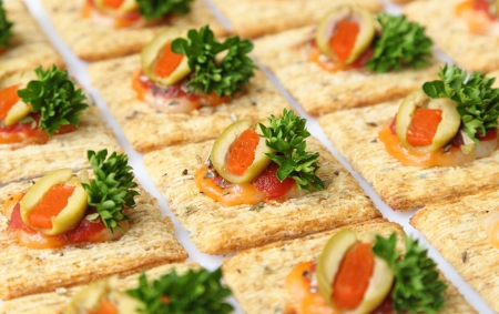 pimento: Baked wheat crackers topped with cheese, olives, parsley, and sauce.