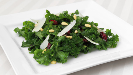 kale: Kale salad served on a square plate Stock Photo