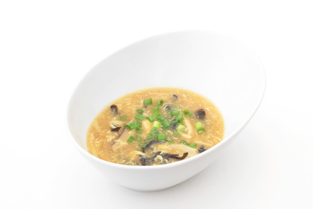 chinese food: A bowl of Hot and Sour Soup on a white background.