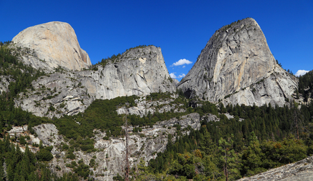 john muir trail: Half Dome (south face), Mount Broderick, and Liberty Cap. Photographed from the John Muir Trail, Yosemite National Park, California. Stock Photo