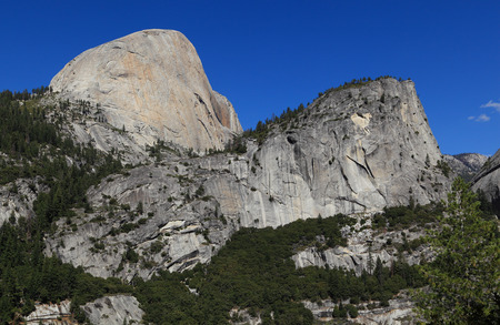 john muir trail: Half Dome (south face) and Mount Broderick. Photographed from the John Muir Trail, Yosemite National Park, California. Stock Photo