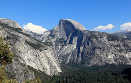 upper half: In view are North Dome, Half Dome, and Yosemite Valley. Photographed looking east from the Upper Yosemite Fall Trail, Yosemite National Park, California.
