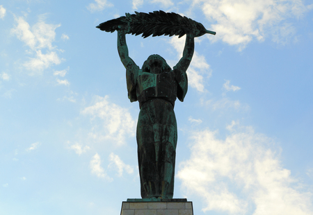 BUDAPEST - SEP 10: Bronze statue of a woman holding a large olive branch on Sep 10, 2013 in Budapest. Designed by Hungarian sculptor Zsigmond Kisfaludi Strobl, it was unveiled in 1947 and sits atop Gellert Hill.