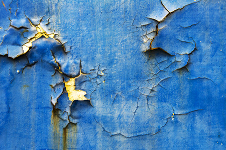 armour plating: Blue wall background, some have rust corrosion cracks