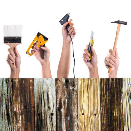 Hand holding many tools on white background photo