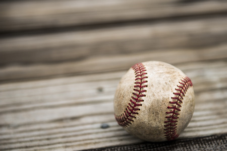 outfielders: Baseball and mitt on rustic wooden background