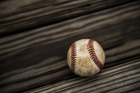 shortstop: Baseball and mitt on rustic wooden background