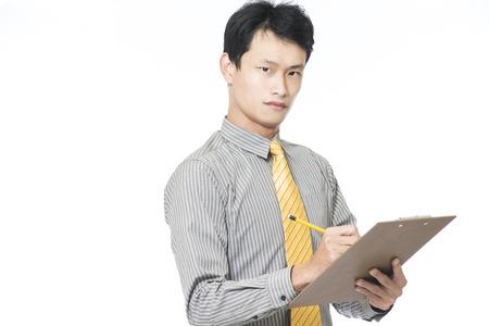 Smiling young businessman pointing upwards isolated over white background. Horizontal shot. photo