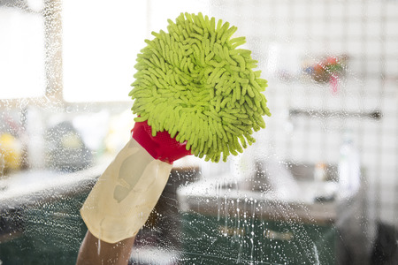 window pane: Cleaning - cleaning window pane with detergent, spring cleaning concept