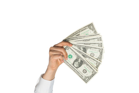 retailing: Hand holding dollars on a white background