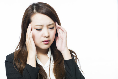 doctor burnout: Business woman physically uncomfortable headache