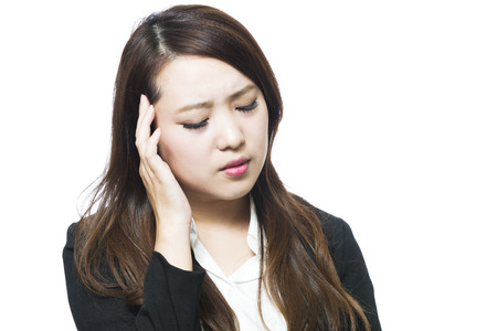 uncomfortable: Business woman physically uncomfortable headache
