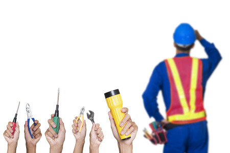 Construction worker with tools isolated white background. photo