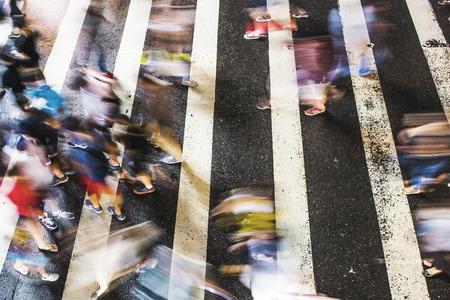 hustle: Zebra pedestrian walking through the streets of Taipei Editorial
