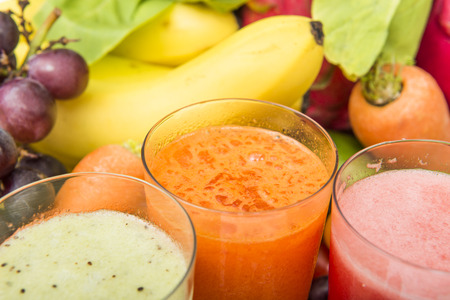 cleanse: Fruit. Glasses of fruit and vegetable juice with fruits on a white background Stock Photo