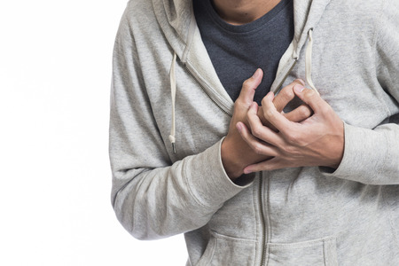 sick person: man feeling heart pain and holding her chest Stock Photo
