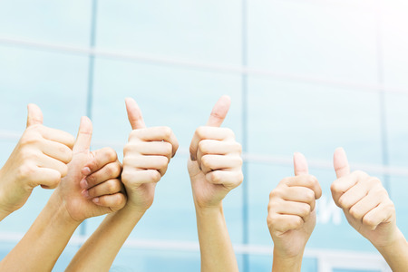 eager: Group of hands with thumbs up expressing positivity