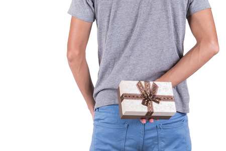 wrapped gift: man holding fine wrapped gift box Stock Photo