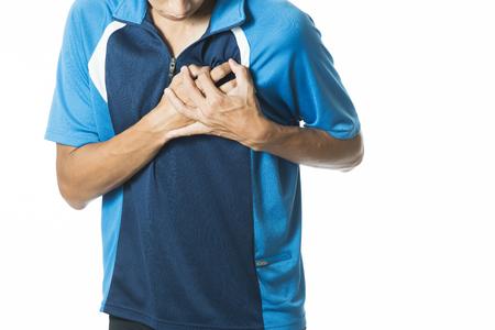 ataque al corazón: hombre sintiendo dolor en el corazón y la celebración de su pecho Foto de archivo
