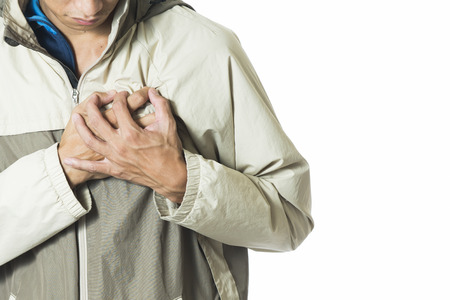 heart pain: man feeling heart pain and holding her chest Stock Photo