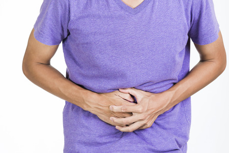 constipation symptom: Man suffering from stomach pain