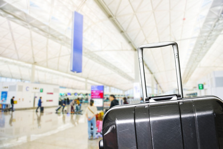 plane window: Traveler Suitcases in Airport Terminal Waiting Area