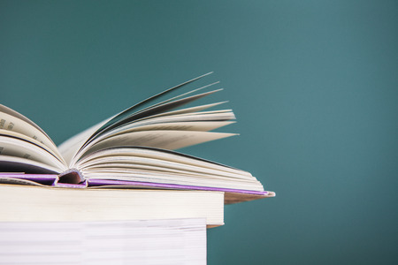 school desk: School book on desk Stock Photo