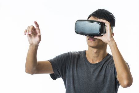 VIRTUAL REALITY: man using the virtual reality headset Stock Photo