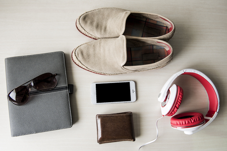 personal accessory: Top view of clothing and diverse personal accessory  on the wooden grain