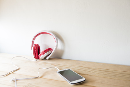 tablet PC and earphones on wooden background Stock Photo