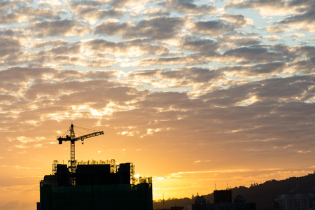 paesaggio industriale: Industrial landscape with silhouettes of cranes on the sunset background
