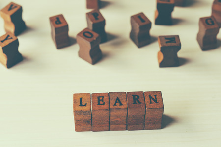 wood block: LEARN word written on wood block Stock Photo
