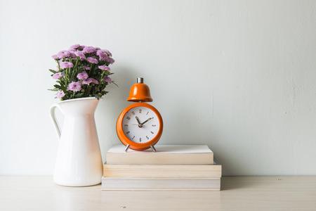 wooden flooring: Interior decoration clock with wooden flooring plant