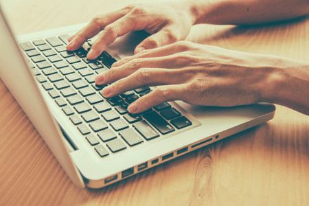 human hands: Closeup of business woman hand typing on laptop keyboard