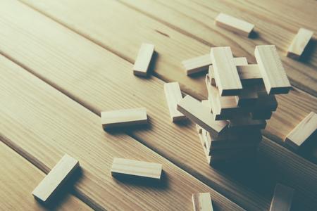 Jenga, Wood blocks stack game on wood background