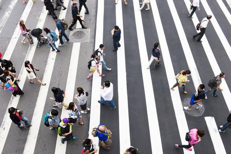 hectic: TAIPEI, TAIWAN, 22 MARCH 2014: Zebra pedestrian walking through the streets of Taipei on the road,22 MARCH 2014 in taipei,taiwan