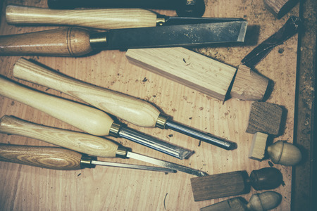 paring: carpenter tools on wood table background
