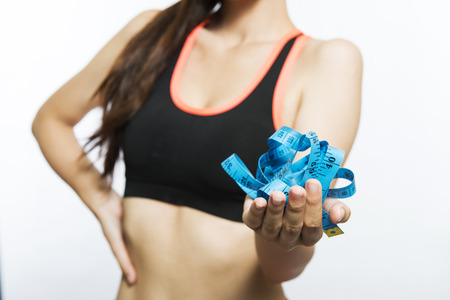 measures: Young woman girl holding  tape measures. Slimming and dieting. Healthy lifestyle
