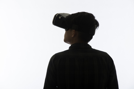 eye pad: Silhouette man portrait, using the virtual reality headset