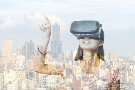 virtual reality simulator: Double exposure of woman using the virtual reality headset