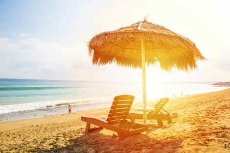 loungers: sun loungers and a beach umbrella