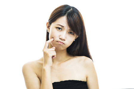 skin problem: Face Skin Problem - young woman unhappy touch her skin isolated, concept for skin care, asian