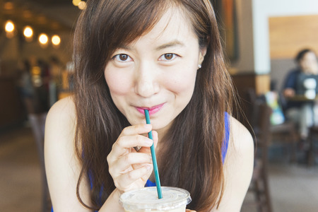 Woman drinking iced coffee