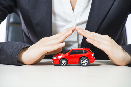 protection hands: car covered of woman hands - insurance concept Stock Photo