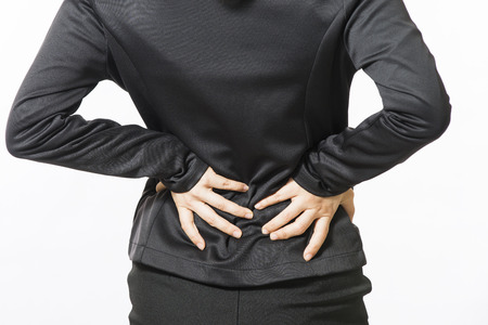 warning back: Business woman with back pain isolated over white background