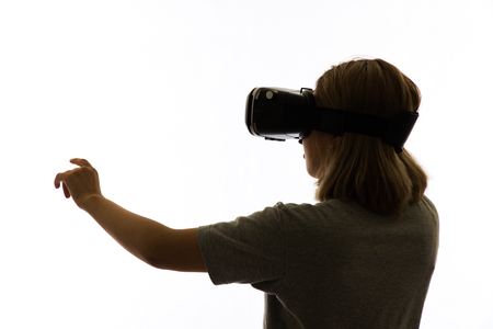 Silhouette woman portrait, using the virtual reality headset