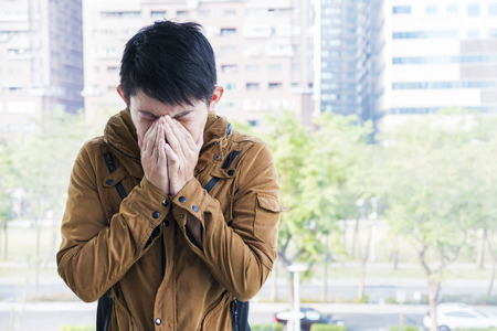 deterrence: Asian man feeling unwell at outdoor