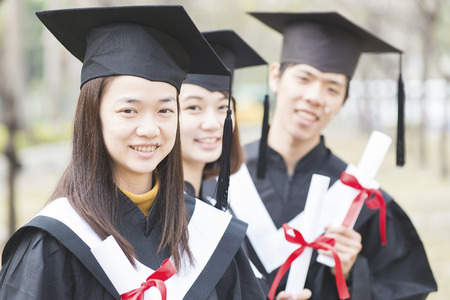 Group of successful students on their graduation day Stock Photo