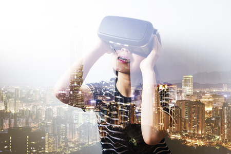 double game: Double exposure of woman using the virtual reality headset