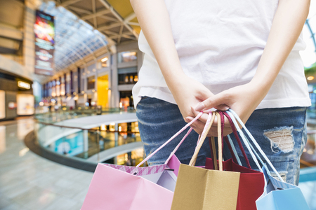 Concept of woman shopping and holding bags, closeup images.